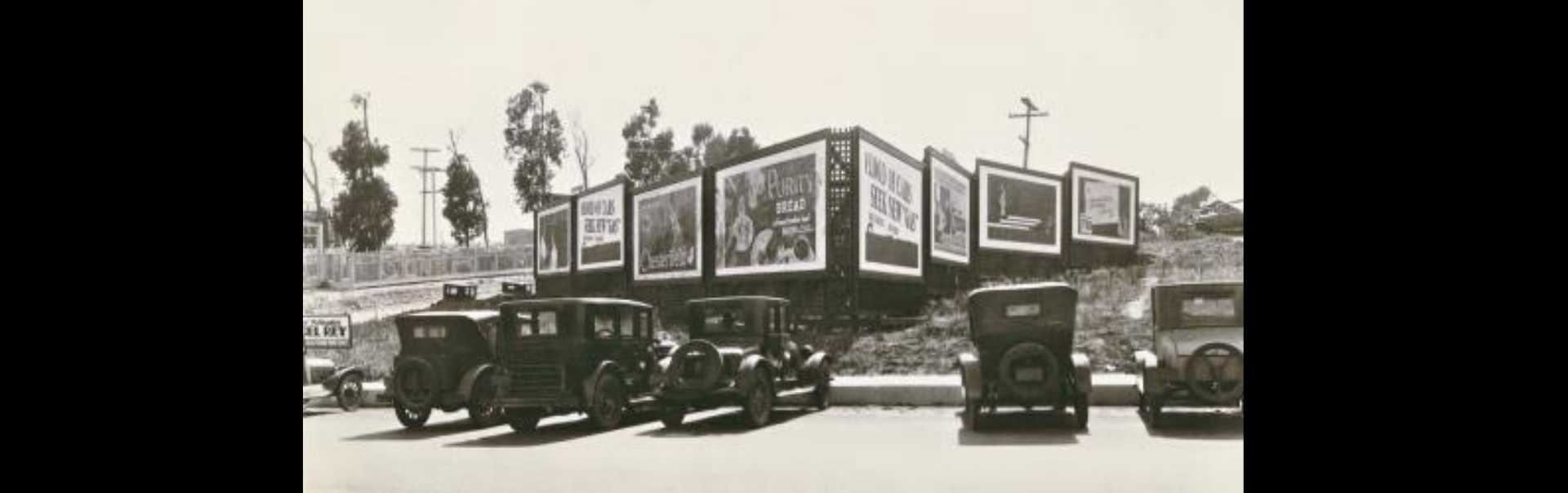 Billboards and Cars at the Corner of Main Street and El Segundo Boulevard 1935
